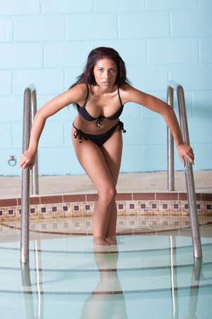 Sexy beautiful woman in swimming pool photo