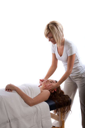 Massage therapist doing face massage