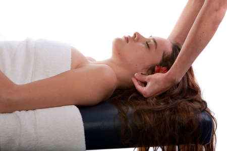 deeptissue: Massage therapist doing ear massage Stock Photo