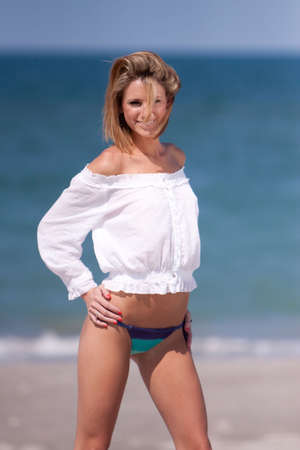 Pretty woman on the beach photo