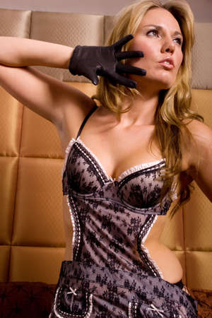 french maid: Sexy girl wearing french maid lingerie Stock Photo