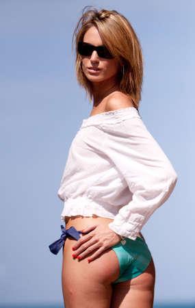 Beautiful blonde woman in sunglasses photo