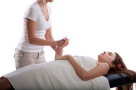 Massage therapist massaging womans hand