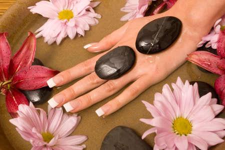 handcare: Woman rejuvenating her hands in water