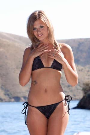 Sexy woman wearing a bikini by the lake Stock Photo - 5568388
