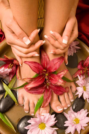 water lily: Womans french manicure and pedicure Stock Photo