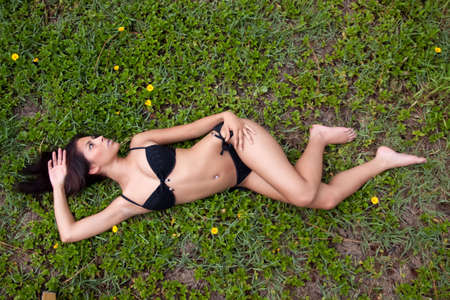 Pretty sexy woman lying in bikini photo