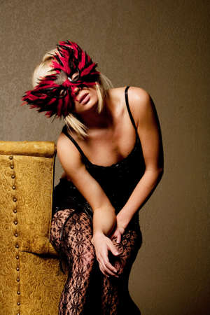 Sexy blonde woman in carnival mask photo