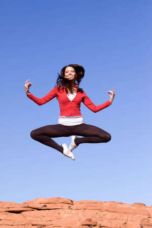 Beautiful young athletic woman jumping high Stock Photo - 5690507