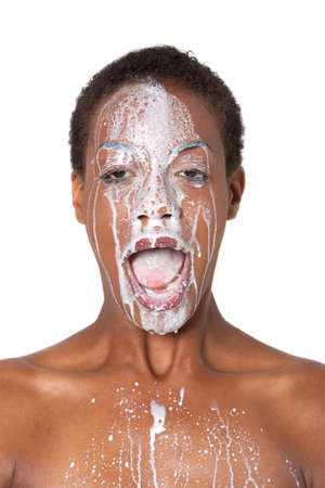 African American woman with milk on her face Stock Photo