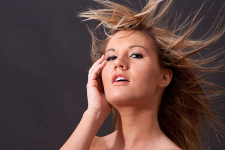 Beautiful young blonde girl with long hairstyle Stock Photo - 5836181