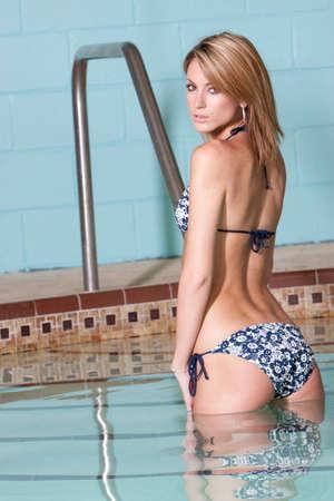 Woman in bikini by the swimming pool photo