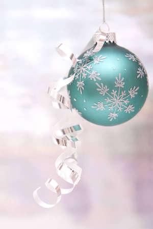 Blue Christmas ornament with shiny ribbon