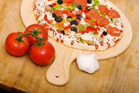 Fresh italian pizza ready to cook photo