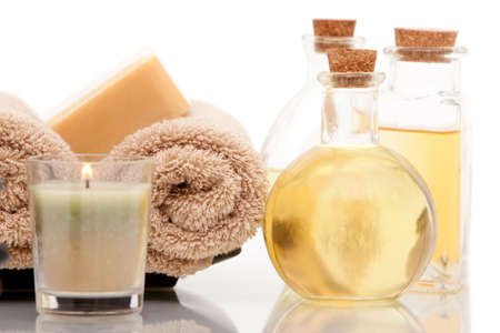 spa towels: Spa towels and aromatherapy oils on white background Stock Photo