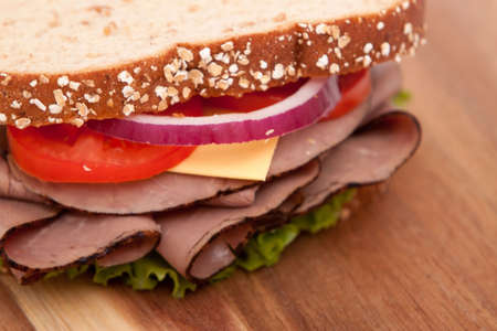 Roast beef sandwich with all the fixings photo