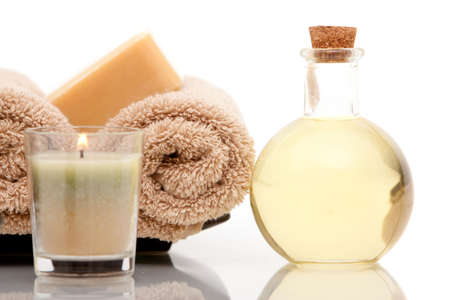 Spa towels and aromatherapy oils on white background Фото со стока