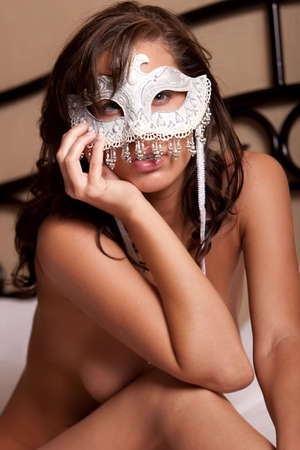 Sexy woman in white mask photo