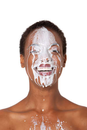 African American woman with milk on her face photo