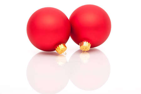 Red Christmas ornaments on white background