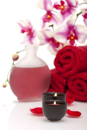 Spa towel, candle, essential oils photo
