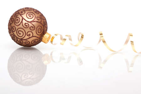 Christmas bauble with ribbon on white background