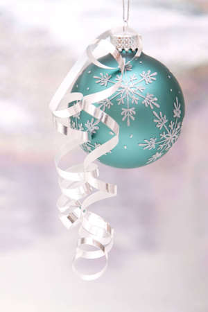 Blue Christmas ornament with shiny ribbon