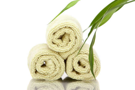 Spa towels and bamboo on white background photo