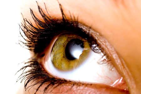 Hazel color eye of a woman Фото со стока