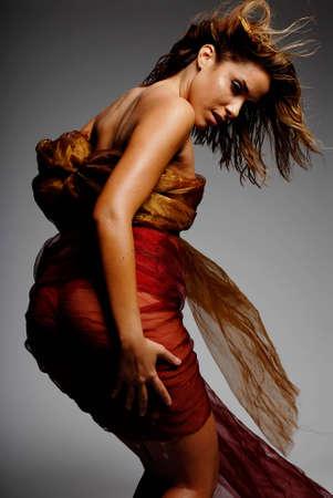Beautiful hispanic woman wrapped in silk photo