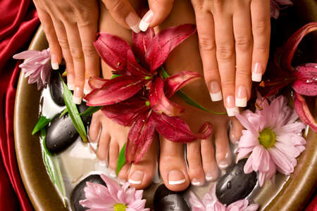 manicure salon: Womans french manicure and pedicure Stock Photo