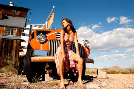 truck: Sexy woman posing on a truck