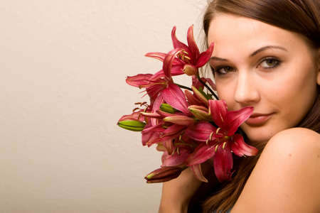 Pretty young woman with lily flowers