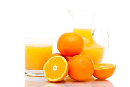 Oranges with orange juice on white background