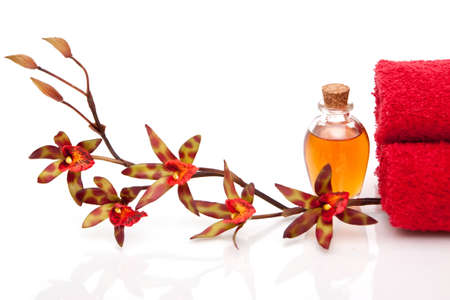 Essential oils, spa towels and orchid