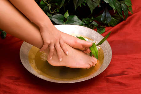 handcare: Woman taking care of her feet