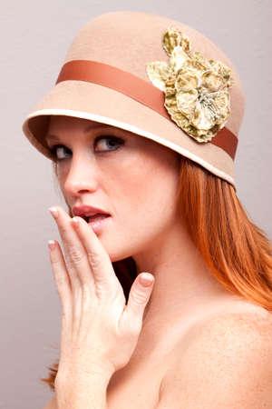 Pretty shy woman wearing a hat