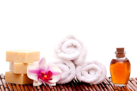 White spa towels, natural soap bars, essential oils for spa decor