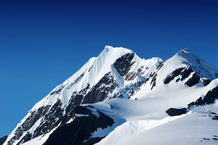 mountain top: Snowy mountain peaks in Alaska Stock Photo