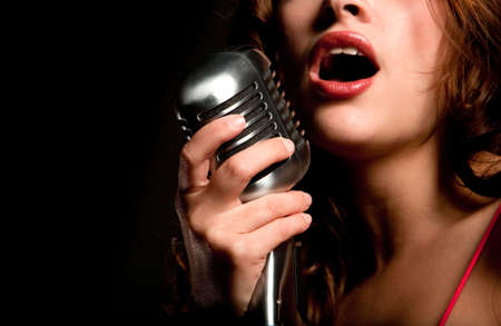 microphone retro: Beautiful singer singing with a retro microphone