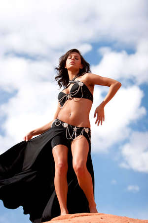 bellydancing: Beautiful sexy bellydancer in the desert Stock Photo