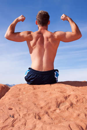 Back of a muscular young man photo