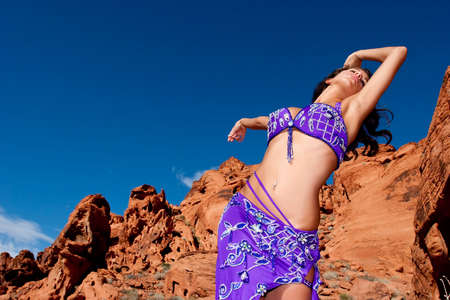 Beautiful sexy bellydancer in the desert Stock Photo