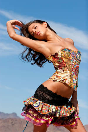 Sexy woman in corset in desert photo