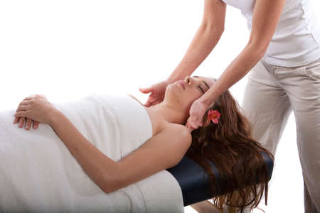 Massage therapist massaging womans neck