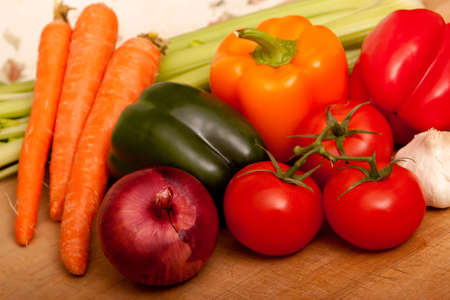Fresh tomatoes, carrots, onions, bell peppers , celery and garlic photo
