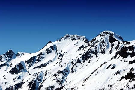 Snowy mountain peaks in Alaska photo