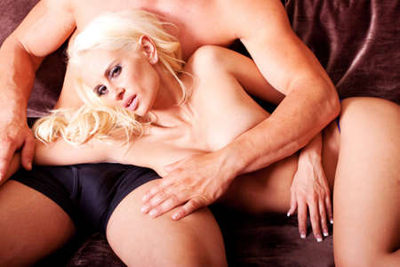 Sexy blonde woman and man