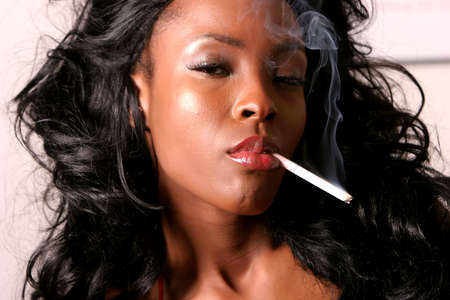 smoking girl: Sexy African American young woman smoking cigarette Stock Photo