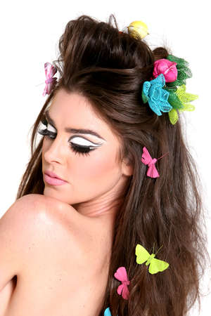 high fashion: Gorgeous young woman wearing high fashion style makeup and hairdo Stock Photo